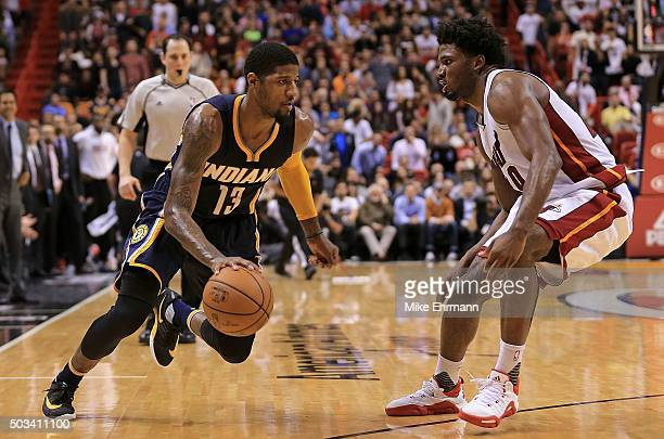 Paul George of the Indiana Pacers drives on Justise Winslow of the Miami Heat during a game at American Airlines Arena on January 4 2016 in Miami...