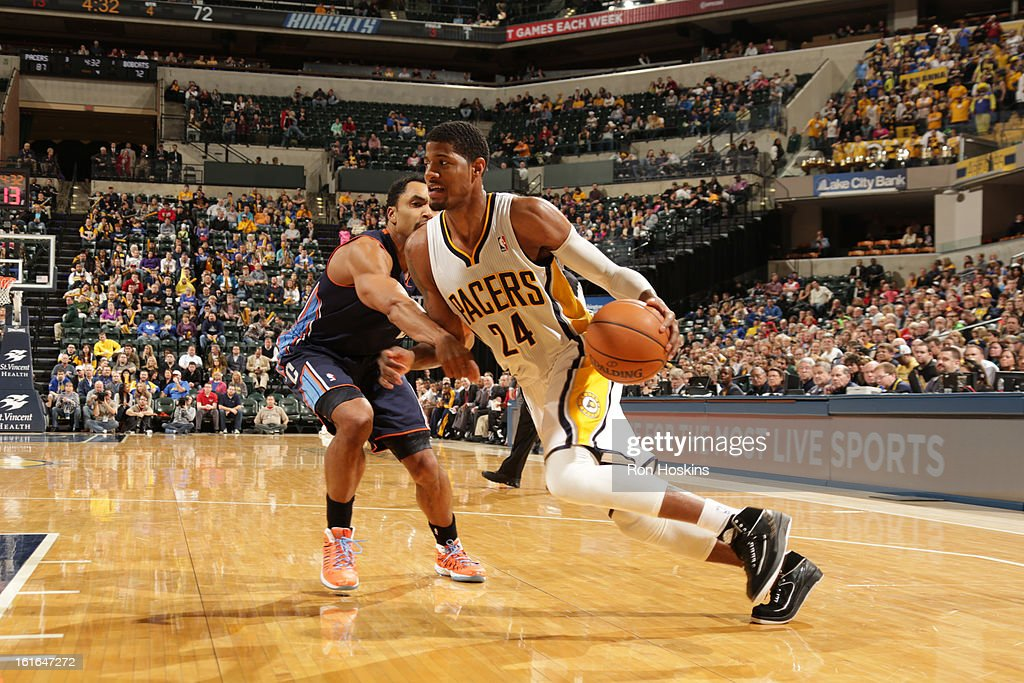Paul George #24 of the Indiana Pacers drives to the basket against Gerald Henderson #9 of the Charlotte Bobcats on February 13, 2013 at Bankers Life Fieldhouse in Indianapolis, Indiana.