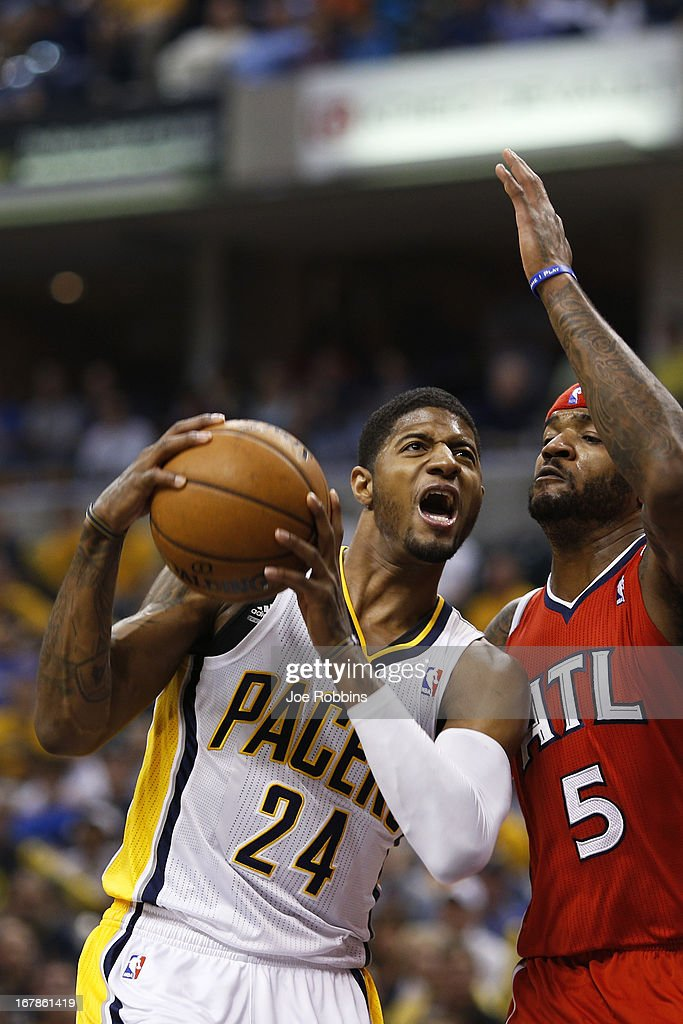 Paul George #24 of the Indiana Pacers drives to the basket against Josh Smith #5 of the Atlanta Hawks during the first quarter of Game Five of the Eastern Conference first round of the 2013 NBA Playoffs at Bankers Life Fieldhouse on May 1, 2013 in Indianapolis, Indiana.