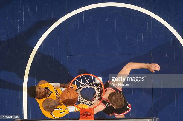 Paul George of the Indiana Pacers dunks against the Chicago Bulls at Bankers Life Fieldhouse on March 21 2014 in Indianapolis Indiana NOTE TO USER...