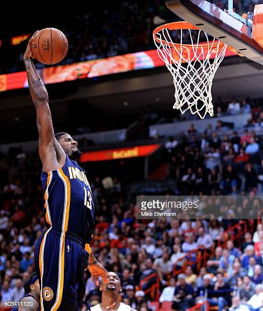 Paul George of the Indiana Pacers dunks during a game against the Miami Heat at American Airlines Arena on January 4 2016 in Miami Florida NOTE TO...