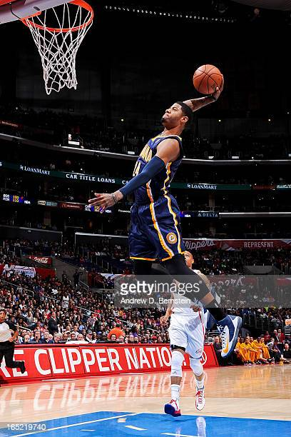 Paul George of the Indiana Pacers dunks on a fast break against the Los Angeles Clippers at Staples Center on April 1 2013 in Los Angeles California...