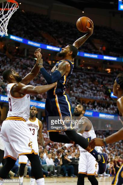 Paul George of the Indiana Pacers dunks over Tristan Thompson of the Cleveland Cavaliers during the first half in Game Two of the Eastern Conference...