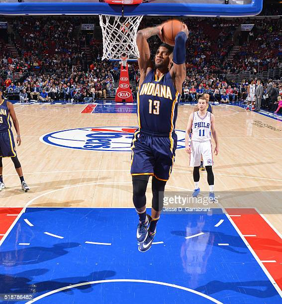 Paul George of the Indiana Pacers dunks the ball against the Philadelphia 76ers at the Wells Fargo Center on April 2 2016 in Philadelphia...