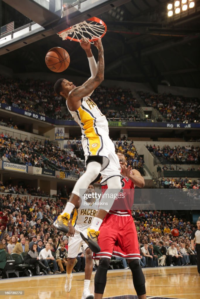 Paul George #24 of the Indiana Pacers dunks the ball during the game between the Indiana Pacers and the Chicago Bulls on February 4, 2013 at Bankers Life Fieldhouse in Indianapolis, Indiana.