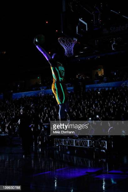 Paul George of the Indiana Pacers glows in the dark as he competes during the Sprite Slam Dunk Contest part of 2012 NBA AllStar Weekend at Amway...