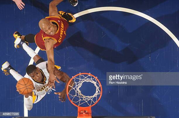 Paul George of the Indiana Pacers goes up for the shot against the Cleveland Cavaliers at Bankers Life Fieldhouse on December 28 2013 in Indianapolis...
