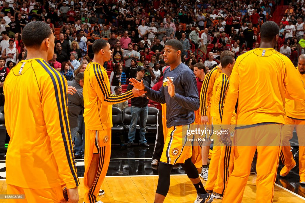 Paul George #24 of the Indiana Pacers greets teammates before playing against the Miami Heat on March 10, 2013 at American Airlines Arena in Miami, Florida.