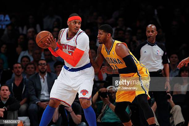 Paul George of the Indiana Pacers guards Carmelo Anthony of the New York Knicks during Game Two of the Eastern Conference Semifinals of the 2013 NBA...