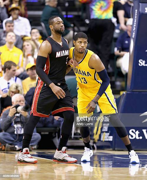Paul George of the Indiana Pacers guards Dwyane Wade of the Miami Heat at Bankers Life Fieldhouse on April 5 2015 in Indianapolis Indiana Tonight is...