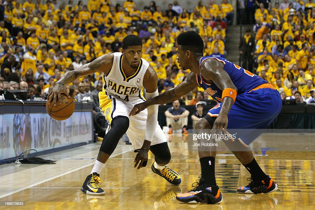 Paul George #24 of the Indiana Pacers handles the ball against Iman Shumpert #21 of the New York Knicks during game three of the Eastern Conference Semifinals of the 2013 NBA Playoffs at Bankers Life Fieldhouse on May 11, 2013 in Indianapolis, Indiana.