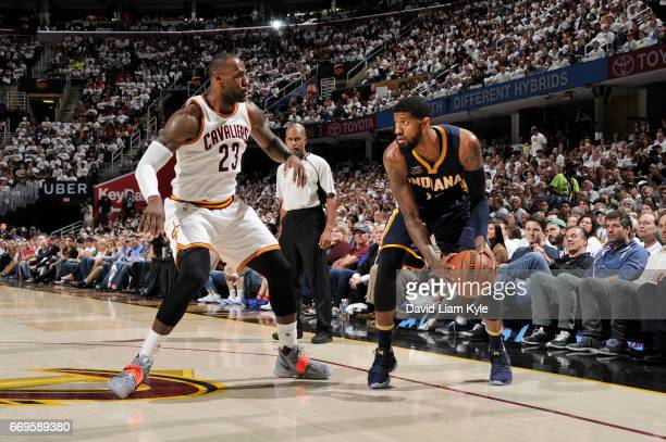 Paul George of the Indiana Pacers handles the ball against LeBron James of the Cleveland Cavaliers during Game Two of the Eastern Conference...