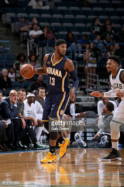 54b211300fb1 Paul George of the Indiana Pacers handles the ball against the Milwaukee  Bucks during a preseason