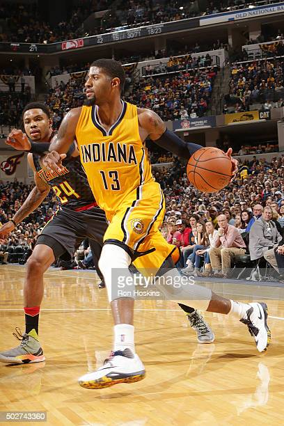 Paul George of the Indiana Pacers handles the ball against the Atlanta Hawks on December 28 2015 at Bankers Life Fieldhouse in Indianapolis Indiana...