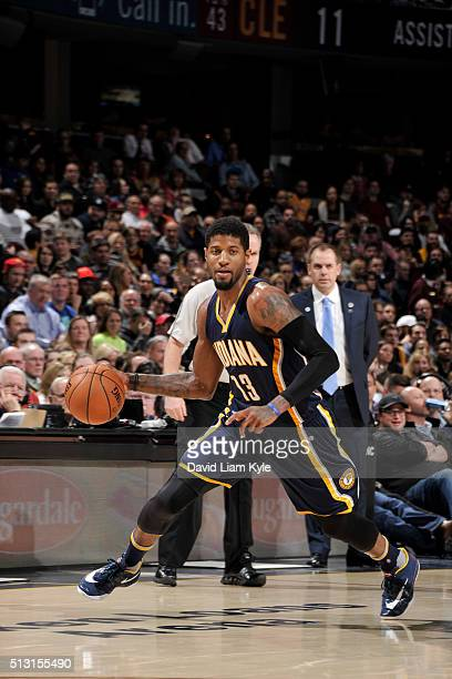 Paul George of the Indiana Pacers handles the ball against the Cleveland Cavaliers on February 29 2016 at Quicken Loans Arena in Cleveland Ohio NOTE...
