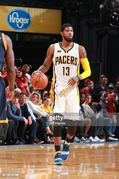 Paul George of the Indiana Pacers handles the ball against the Cleveland Cavaliers during Game Four of the Eastern Conference Quarterfinals of the...