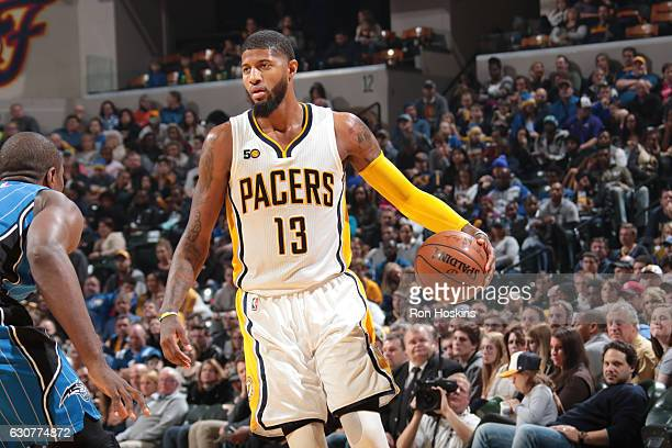 Paul George of the Indiana Pacers handles the ball during a game against the Orlando Magic on January 1 2017 at Bankers Life Fieldhouse in...