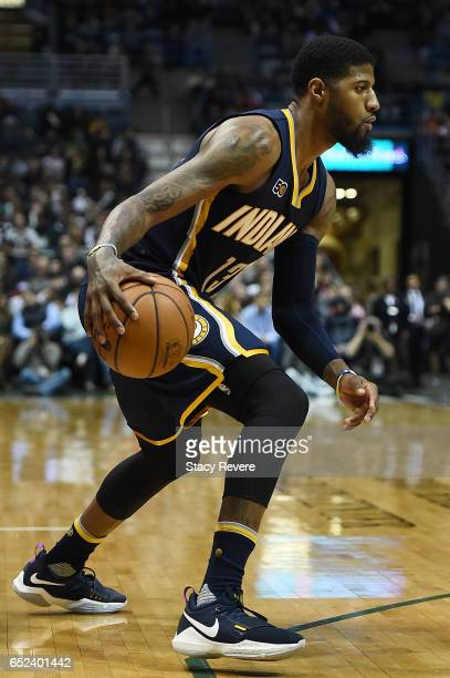 1f82d10edb7e Paul George of the Indiana Pacers handles the ball during a game against  the Milwaukee Bucks