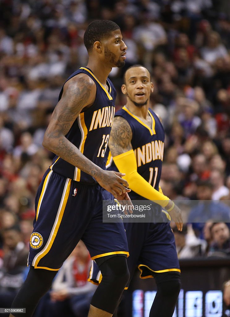 Paul George #13 of the Indiana Pacers is congratulated by Monta Ellis #11 after George scored a basket against the Toronto Raptors in Game One of the Eastern Conference Quarterfinals during the 2016 NBA Playoffs on April 16, 2016 at the Air Canada Centre in Toronto, Ontario, Canada.