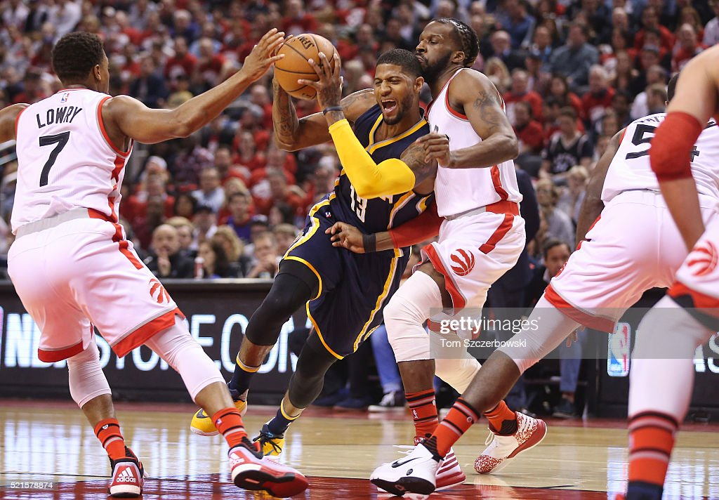 Paul George #13 of the Indiana Pacers is fouled as he goes to the basket against DeMarre Carroll #5 of the Toronto Raptors in Game One of the Eastern Conference Quarterfinals during the 2016 NBA Playoffs on April 16, 2016 at the Air Canada Centre in Toronto, Ontario, Canada.