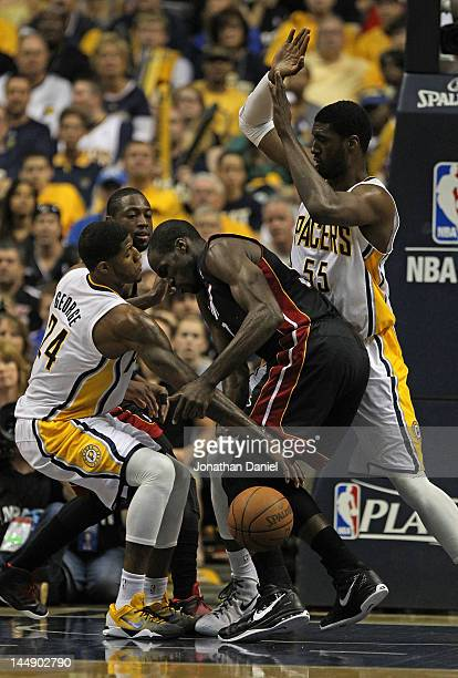 Paul George of the Indiana Pacers knocks the ball away from Joel Anthony of the Miami Heat as Roy Hibbert defends in Game Four of the Eastern...