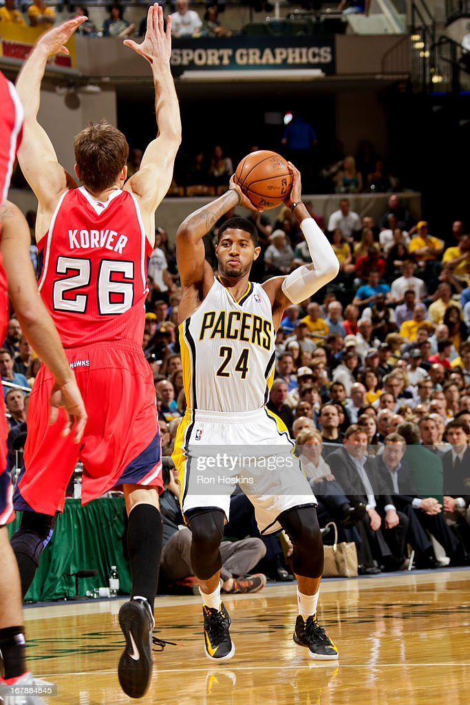 Paul George #24 of the Indiana Pacers looks to pass the ball against Kyle Korver #26 of the Atlanta Hawks in Game Five of the Eastern Conference Quarterfinals during the 2013 NBA Playoffs on May 1, 2013 at Bankers Life Fieldhouse in Indianapolis, Indiana.