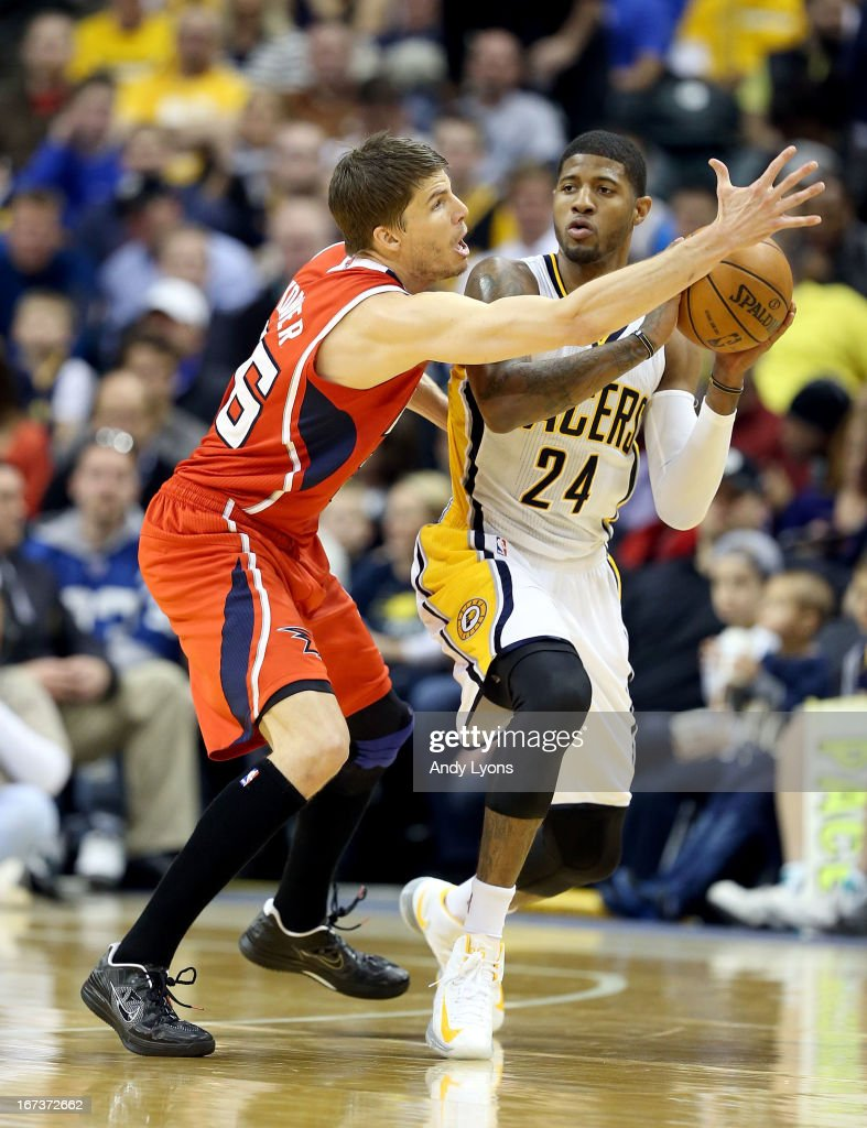 Paul George #24 of the Indiana Pacers looks to pass the ball while defended by Kyle Korver #26 of the Atlanta Hawks during Game Two of the Eastern Conference Quarterfinals of the 2013 NBA Playoffs at Bankers Life Fieldhouse on April 24, 2013 in Indianapolis, Indiana.