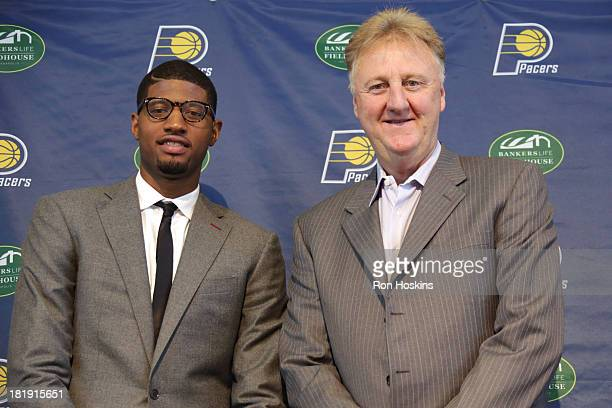 Paul George of the Indiana Pacers poses for a picture with Larry Bird the team president of the Indiana Pacers during a press conference at Bankers...