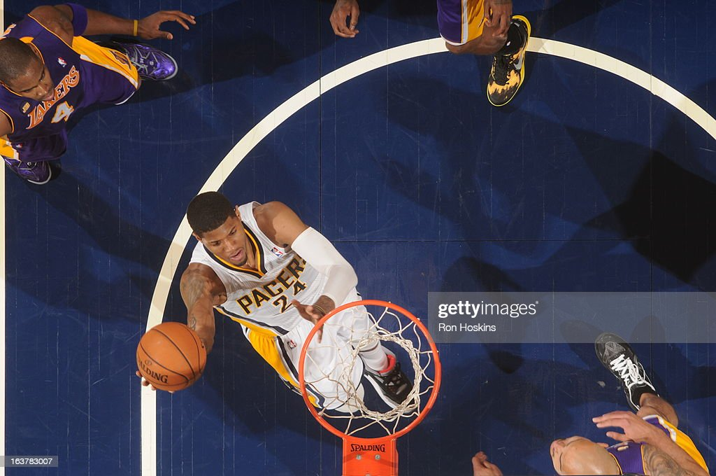 Paul George #24 of the Indiana Pacers shoots a layup against the Los Angeles Lakers on March 15, 2013 at Bankers Life Fieldhouse in Indianapolis, Indiana.