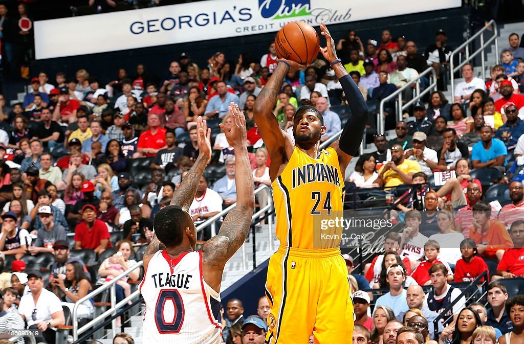 Paul George #24 of the Indiana Pacers shoots a three-point basket against Jeff Teague #0 of the Atlanta Hawks in Game Four of the Eastern Conference Quarterfinals during the 2014 NBA Playoffs at Philips Arena on April 26, 2014 in Atlanta, Georgia.