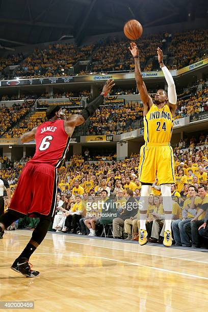 Paul George of the Indiana Pacers shoots against LeBron James of the Miami Heat in game one of the East Conference Finals at Bankers Life Fieldhouse...