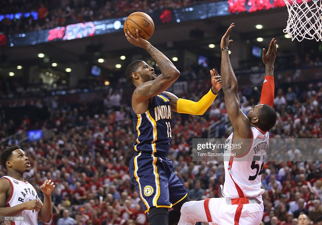 Paul George #13 of the Indiana Pacers shoots against Patrick Patterson #54 of the Toronto Raptors in Game One of the Eastern Conference Quarterfinals during the 2016 NBA Playoffs on April 16, 2016 at the Air Canada Centre in Toronto, Ontario, Canada.