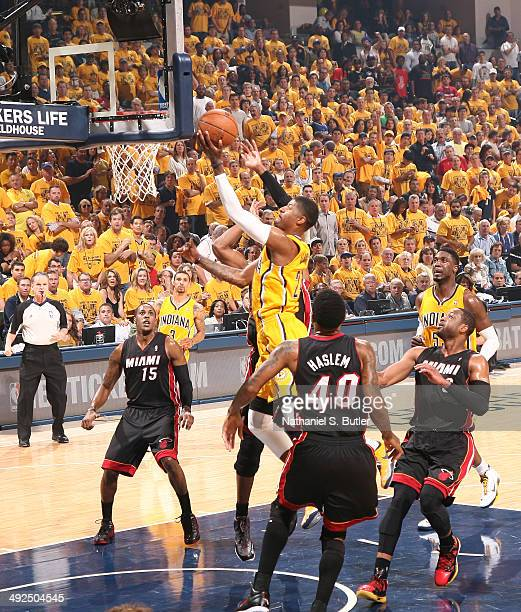 Paul George of the Indiana Pacers shoots against Udonis Haslem of the Miami Heat during Game Two of the Eastern Conference Finals on May 20 2014 at...