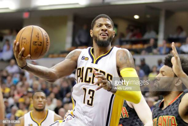 Paul George of the Indiana Pacers shoots the ball against the Atlanta Hawks at Bankers Life Fieldhouse on April 12 2017 in Indianapolis Indiana NOTE...