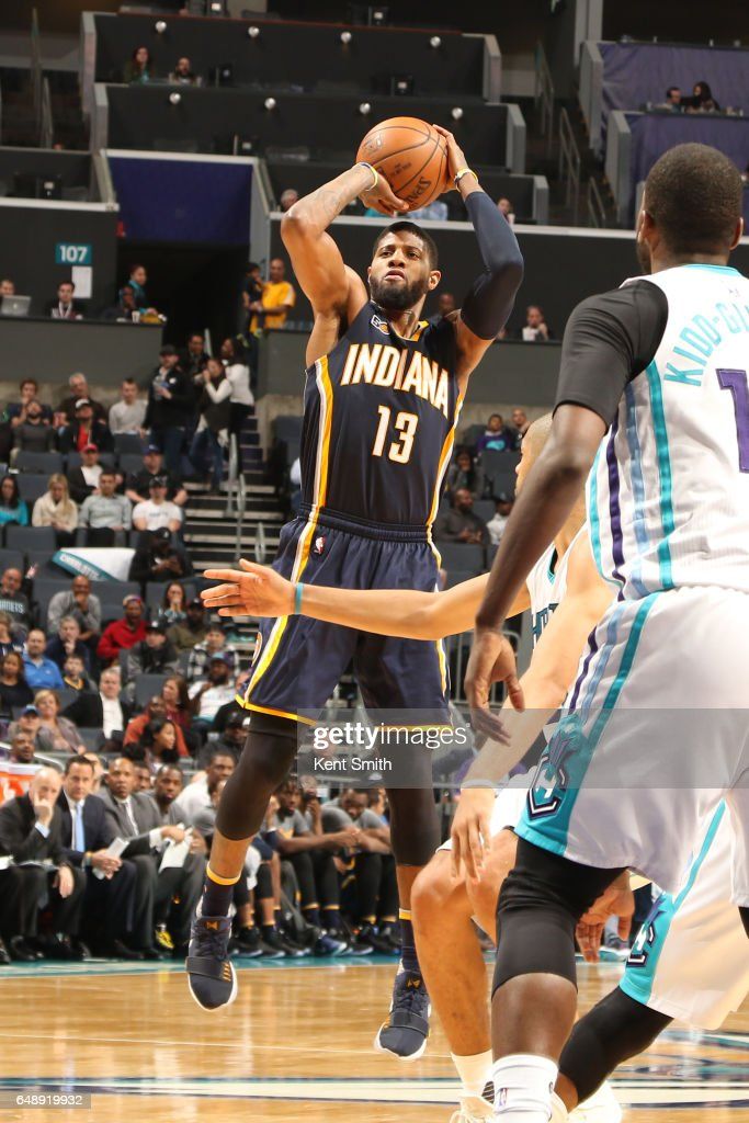 Paul George #13 of the Indiana Pacers shoots the ball against the Charlotte Hornets on March 6, 2017 at Spectrum Center in Charlotte, North Carolina.