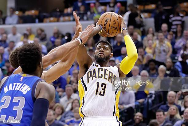 Paul George of the Indiana Pacers shoots the ball in overtime during the game against the Dallas Mavericks at Bankers Life Fieldhouse on October 26...