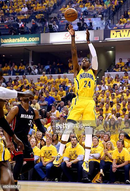 Paul George of the Indiana Pacers takes a shot against the Miami Heat during Game Two of the Eastern Conference Finals of the 2014 NBA Playoffs at at...