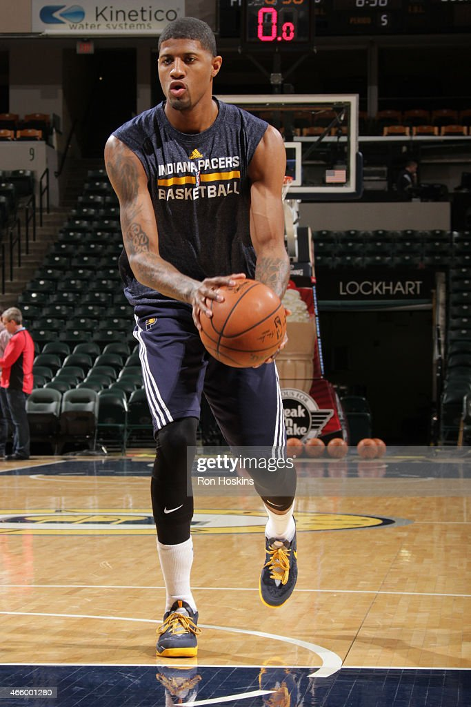 Paul George #13 of the Indiana Pacers warms up before the game against the Milwaukee Bucks on March 12, 2015 at Bankers Life Fieldhouse in Indianapolis, Indiana.