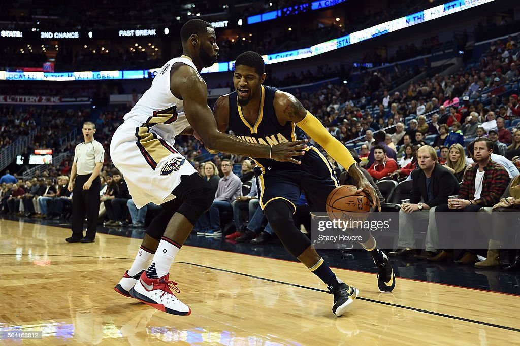 0d0570ea9f9 Paul George of the Indiana Pacers works against Tyreke Evans of the ...