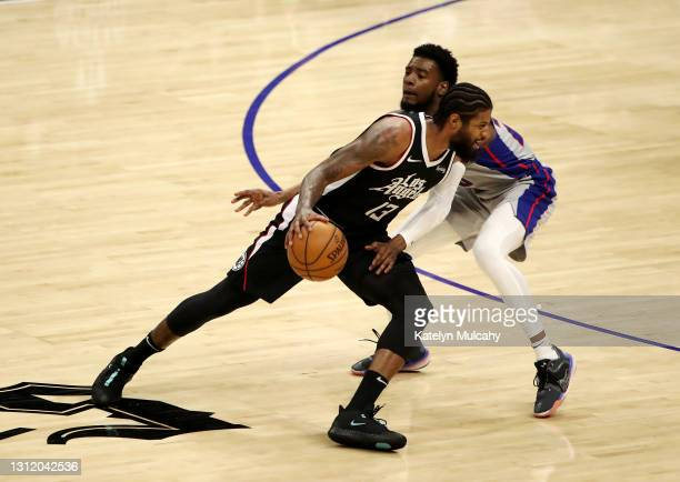 Paul George of the Los Angeles Clippers dribbles against Josh Jackson of the Detroit Pistons during the third quarter at Staples Center on April 11,...