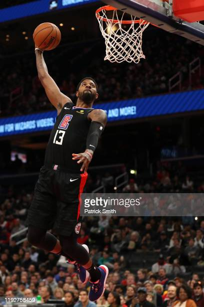 Paul George of the Los Angeles Clippers dunks against the Washington Wizards during the first half at Capital One Arena on December 8, 2019 in...
