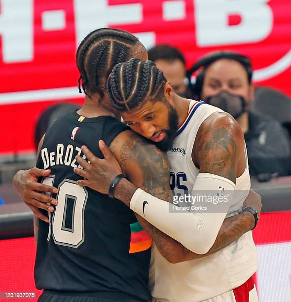 Paul George of the Los Angeles Clippers hugs DeMar DeRozan of the San Antonio Spurs at the end of the game at AT&T Center on March 25, 2021 in San...