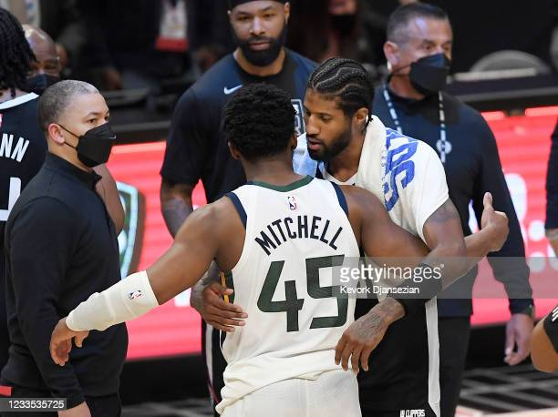 Paul George of the Los Angeles Clippers hugs Donovan Mitchell of the Utah Jazz with head coach Tyronn Lue looking on after the Jazz were eliminated...