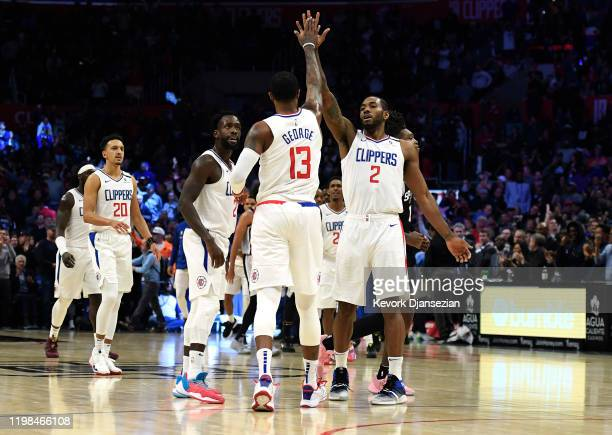 Paul George of the Los Angeles Clippers is congratulated by Kawhi Leonard after scoring against San Antonio Spurs at Staples Center on February 3,...