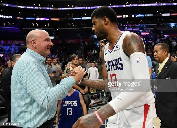 Paul George of the Los Angeles Clippers is congratulated by owner owner Steve Ballmer after an overtime win over Boston Celtics, 107-104, at Staples...