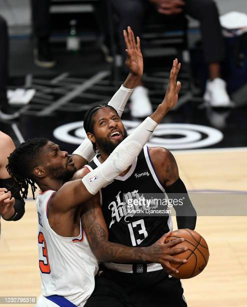 Paul George of the Los Angeles Clippers is defended by Nerlens Noel of the New York Knicks during the first half of the game at Staples Center on May...
