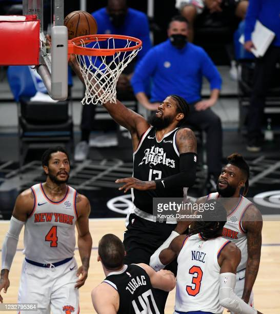 Paul George of the Los Angeles Clippers scores a basket against Nerlens Noel of the New York Knicks during the first half of the game at Staples...
