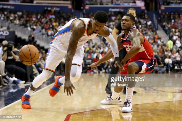 Paul George of the Oklahoma City Thunder and Bradley Beal of the Washington Wizards go after the ball during the first half at Capital One Arena on...