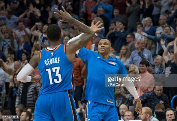 Paul George of the Oklahoma City Thunder and Russell Westbrook of the Oklahoma City Thunder celebrate during the second half of a NBA game against...