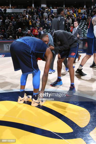 Paul George of the Oklahoma City Thunder and Terrance Ferguson of the Oklahoma City Thunder speak before the game against the Indiana Pacers on...